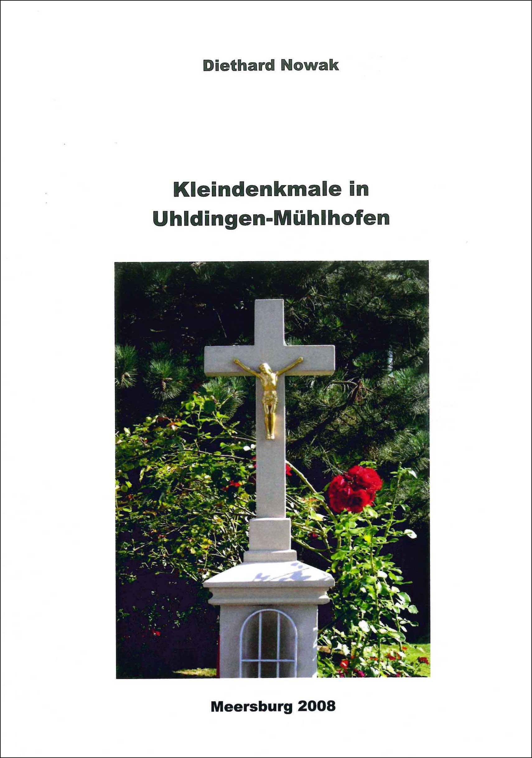 Buchvorderseite mit einem steinernen Kreuz vor einem Rosenbusch